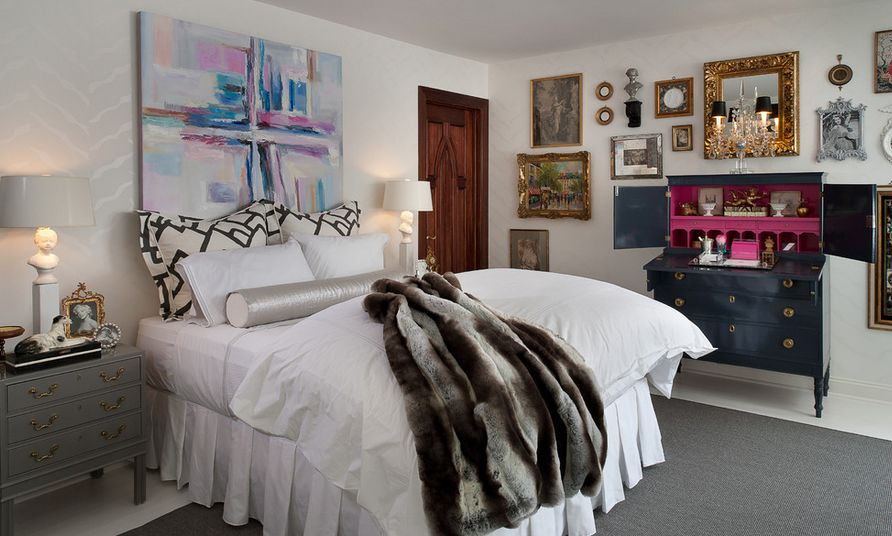 Abstract canvas art above the bed