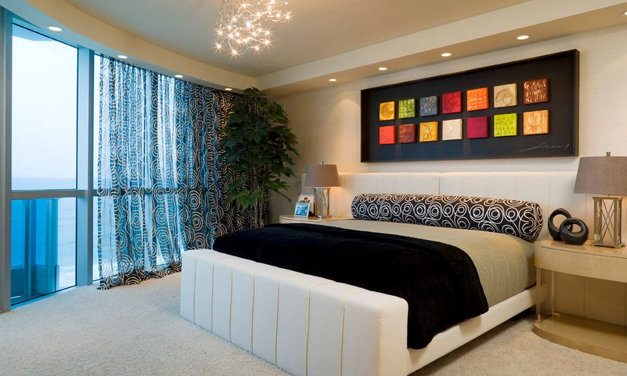 Colorful art above the bed